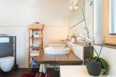 Detail of basin on wooden board with decoration in bathroom — Stock Photo