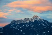 Orange afterglow clouds over tirol mountain at winter — Stock Photo