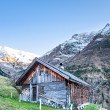 Old wooden timber chalet in snowy tirol mountain alps — Stock Photo #61922187