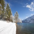 Winter footpath tracks in snow at cold lake in tirol austria — Stock Photo #62820333