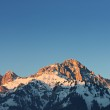 Glowing orange mountain peak at sunset in tirol alps — Stock Photo #64578793