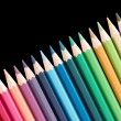 Several wooden colored pencils arranged in a line — Stock Photo #67644087