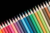 Several wooden colored pencils arranged in a line — Stock Photo