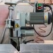 Fixed circular buzz saw with electric motor engine and green red buttons — Stock Photo #69313679