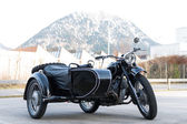 Old black oldtimer motorcycle with trailer side car — Stock Photo