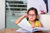 Little cute girl doing homework — Stock Photo