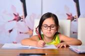 Little cute girl doing homework — Foto de Stock