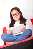 Schoolgirl learning with a Tablet PC at home — Foto Stock