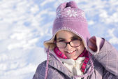 Little girl with glasses posing in the snow — Stock Photo