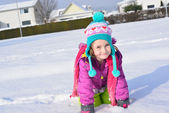 Little girl posing in the snow — Foto de Stock