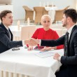 Business contract. Three successful and confident businesspeople — Stock Photo #52882885