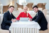 Successful team of three successful businessman discussing work  — Stock Photo