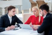 Teamwork. Three successful businessman discussing work at a lapt — Stock Photo