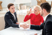 Specials. Three successful and confident businesspeople shake ha — Stock Photo