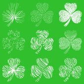 Vector set of scribbled hand drawn  clovers — Stock Vector