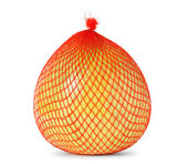 Yellow pomelo wrapped in plastic and mesh — Stock Photo