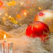 Christmas balls with candles on the background lights — Stock Photo #57452603