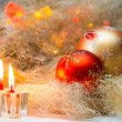 Christmas balls with candles on the background lights — Stock Photo #57452611