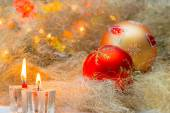 Christmas balls with candles on the background lights — Stock Photo