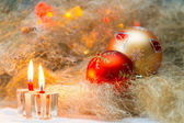 Christmas balls with candles on the background lights — Zdjęcie stockowe