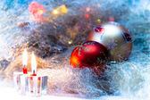 Christmas still life with candles and Christmas decorations — Stock Photo
