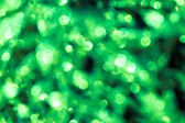 Green sequins in bokeh - background and festive atmosphere, hol — Stok fotoğraf