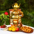 Постер, плакат: Russian samovar and tea strawberries on the plate Gzhel lemons flowers drying and bagels