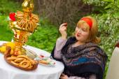 Beautiful Russian girl with a curvaceous, rosy and happy sitting — Stock Photo