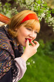 Charming rosy-cheeked young woman dressed in Russian style with — Stock Photo