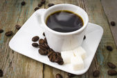 Coffee  with sugar and beans — Stock Photo