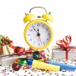 Alarm clock with Christmas presents — Stock Photo #53646769