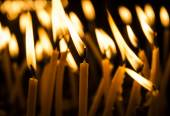 Candles in catholic church — Stock Photo