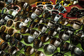 Rows of sunglasses — Stock Photo