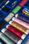 Row of thread spools — Stock Photo