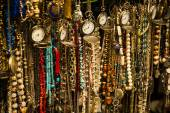 Colorful beads and watches — Stock Photo