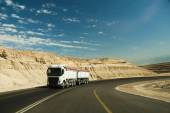 Truck driving on desert road. — Stock Photo