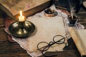 Vintage candle, compass and glasses — Stock Photo