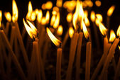 Burning candles in a church — Stock Photo