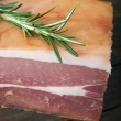 Prosciutto  with rosemary herb — Stock Photo #69087571