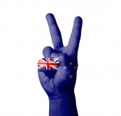 Hand making the V sign, New Zealand flag painted — Stock Photo