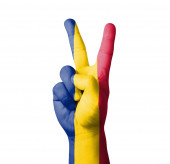 Hand making the V sign, Romania flag painted — Stock Photo