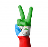 Hand making the V sign, Equatorial Guinea flag painted — Stock fotografie
