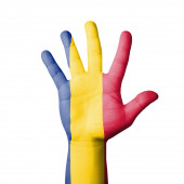 Open hand raised, Romania flag painted — Stock Photo