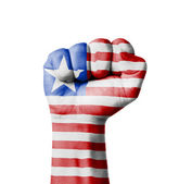 Fist of Liberia flag painted — Stock Photo