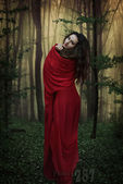 Mysterious dark woman in forest at night. Book cover — Stock Photo
