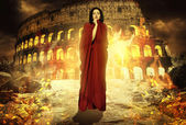 Beautiful woman in fire. Priestess praying to god. Rome. Fantasy woman. Book cover — Stock Photo