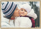 Mother with child outdoors in park — Stockfoto