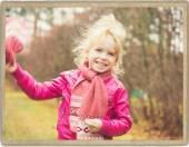 Girl child walking in park alone — Stock Photo
