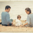 Family together on nature in stripes same clothes — Stock Photo #61850339