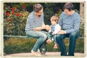 Family together on nature in stripes same clothes — Stock Photo